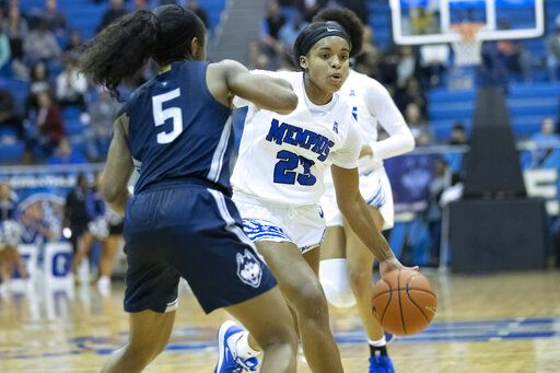 Memphis guard Jamirah Shutes (23) drives defended by Connecticut guard Christyn Williams (5) in the first half of an NCAA college basketball game Tuesday, Jan. 14, 2020, in Memphis, Tenn.