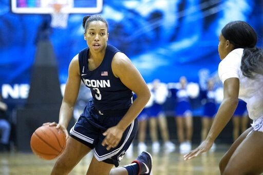 Connecticut forward Megan Walker (3) drives defended by Memphis guard Jamirah Shutes, right, in the first half of an NCAA college basketball game Tuesday, Jan. 14, 2020, in Memphis, Tenn.