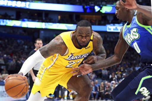 Los Angeles Lakers forward LeBron James (23) tries to drive past Dallas Mavericks forward Dorian Finney-Smith (10) during the second half of an NBA basketball game Friday, Jan. 10, 2020, in Dallas.