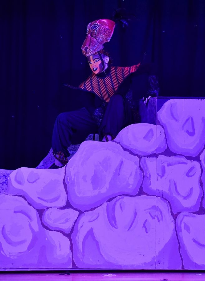 "Scar, played by Zoe Van Krey, slinks among the rocks Wednesday during a dress rehearsal of ""The Lion King Jr."" by Carl Sandburg Middle School students in Mundelein."