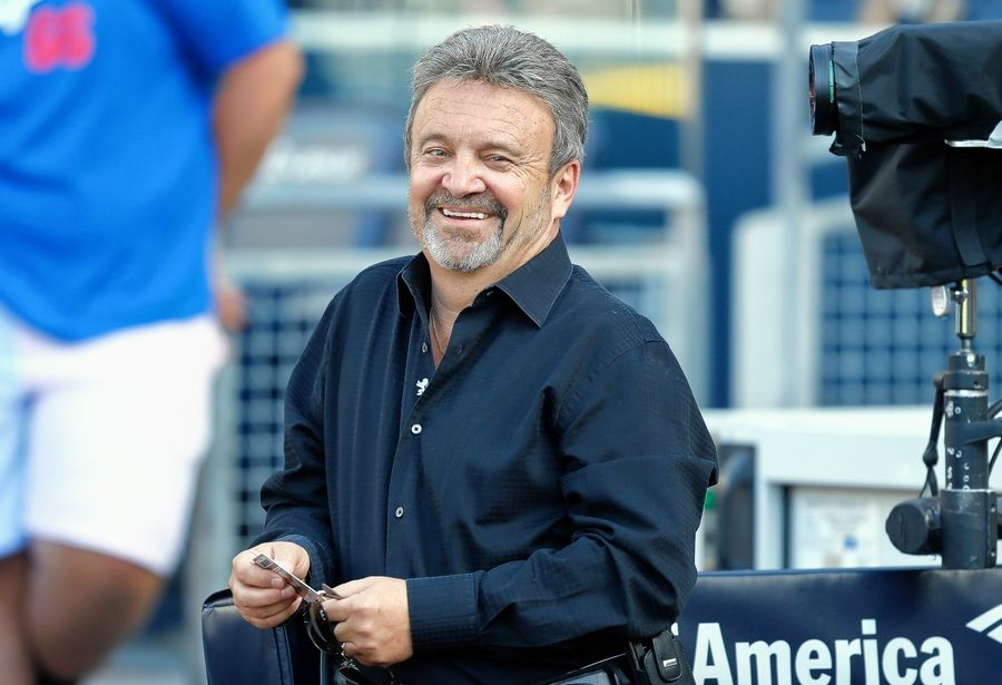 Ned Colletti was the Los Angeles Dodgers general manager in 2014, and today does TV work for the team. He's also a scout for the San Jose Sharks and teaches a class at Pepperdine University. His connection to the NFC Championship is East Leyden High School in Franklin Park, which he recalls fondly.