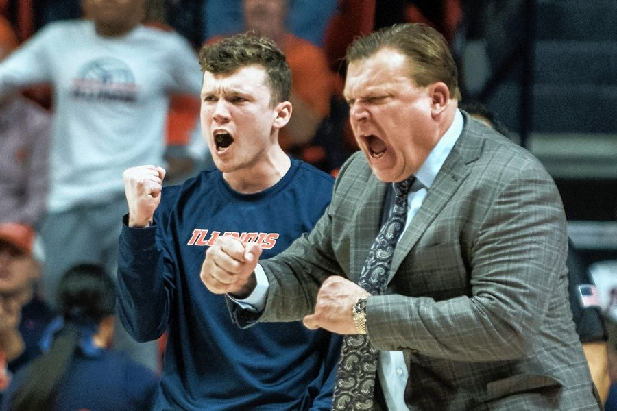 Illinois men's basketball coach Brad Underwood (and his son, Tyler) like what they see from the Illini in a game against Purdue earlier this month in Champaign.
