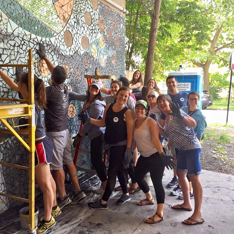 "As part of the ""Selfless for Scott Kindness Challenge,"" volunteers designed a mosaic mural along an underpass in Woodlawn."