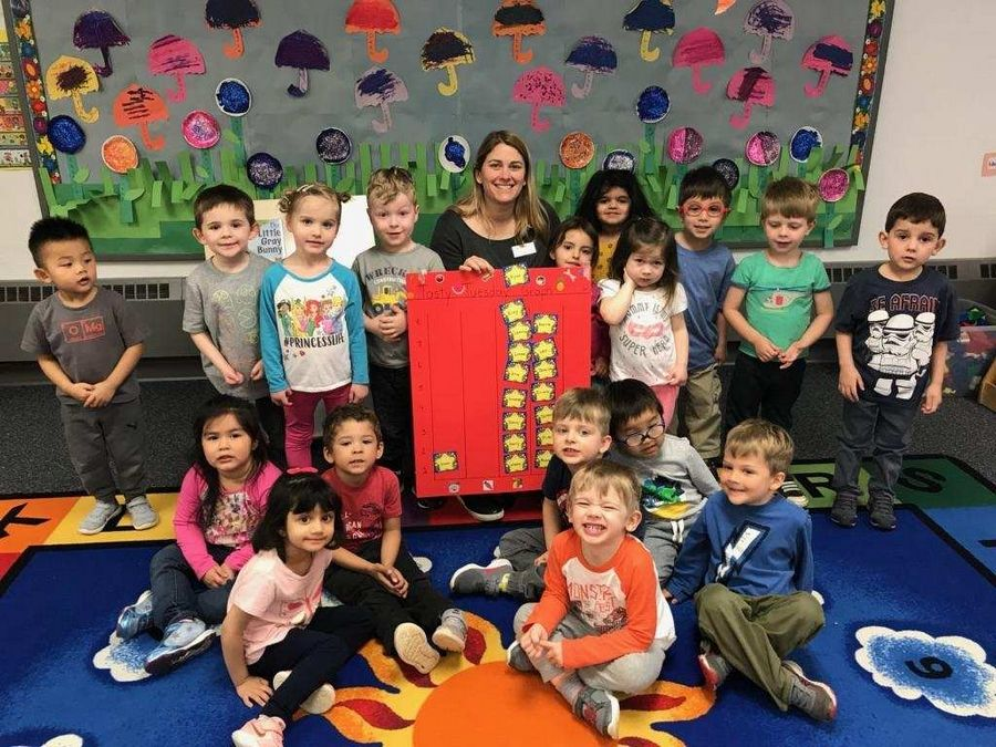 Students at one of the four Palatine Park District preschool's gather with their teacher.