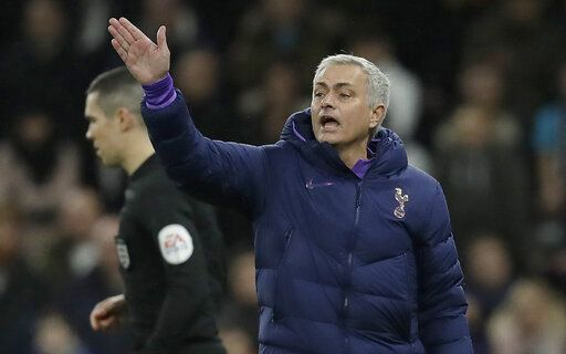 Tottenham's manager Jose Mourinho gestures during the English FA Cup third round replay soccer match between Tottenham Hotspur and Middlesbrough FC at the Tottenham Hotspur Stadium in London, Tuesday, Jan. 14, 2020.
