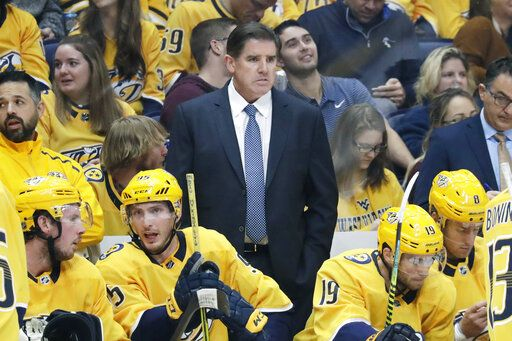 FILE - In this Oct. 8, 2019, file photo, Nashville Predators head coach Peter Laviolette watches the action in an NHL hockey game against the San Jose Sharks, in Nashville, Tenn. Mike Babcock and Laviolette are among the six coaches already fired this season in the NHL.