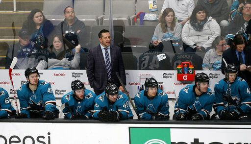 San Jose Sharks interim coach Bob Boughner, center, watches the team play the Dallas Stars during the third period of an NHL hockey game in San Jose, Calif., Saturday, Jan. 11, 2020.