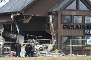 The McHenry Starbucks is fenced off Friday morning after a truck plowed into the business on Elm Street Thursday evening. Five people were injured in the crash.
