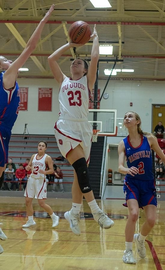 Du Quoin's Delaynie Dearmond puts up a shot in the paint against Nashville.