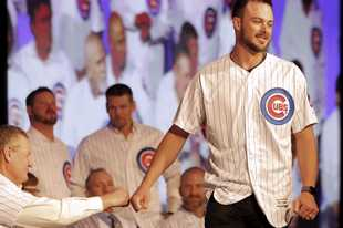 Patrick Kunzer/pkunzer@dailyherald.com Kris Bryant came out for introductions Friday but not anywhere else Friday for the Cubs Convention. The star third baseman didn't get traded. He went to his room at the Chicago Grand Sheraton with the flu.