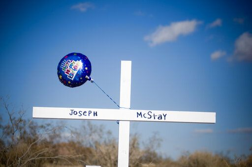 "FILE - In this Wednesday, Nov. 20, 2013 file photo, a birthday balloon blows in the wind after it was placed on a memorial cross for Joseph McStay, whose body, along with his wife and two children were found in a shallow grave, in Victorville, Calif. Charles ""Chase"" Merritt was convicted in June 2019 of the murders of his former business associate Joseph McStay, McStay's wife Summer, and their 4- and 3-year-old sons, Gianni and Joseph Jr. He will learn Friday, Jan. 17, 2020 whether he will face the death penalty. (James Quigg/The Daily Press via AP, File)"