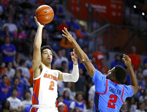 Florida guard Andrew Nembhard (2) shoots over Mississippi guard Devontae Shuler (2) during an NCAA college basketball game Tuesday, Jan. 14, 2020, in Gainesville, Fla. (Brad McClenny/The Gainesville Sun via AP)