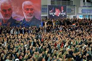 "In this picture released by the official website of the office of the Iranian supreme leader, worshippers chant slogans during Friday prayers ceremony, as a banner show Iranian Revolutionary Guard Gen. Qassem Soleimani, left, and Iraqi Shiite senior militia commander Abu Mahdi al-Muhandis, who were killed in Iraq in a U.S. drone attack on Jan. 3, and a banner which reads in Persian: ""Death To America, ""at Imam Khomeini Grand Mosque in Tehran, Iran, Friday, Jan. 17, 2020. Iran's supreme leader said in his sermons President Donald Trump is a ""clown"" who only pretends to support the Iranian people but will ""push a poisonous dagger"" into their backs, as he struck a defiant tone in his first Friday sermon in Tehran in eight years. (Office of the Iranian Supreme Leader via AP)"
