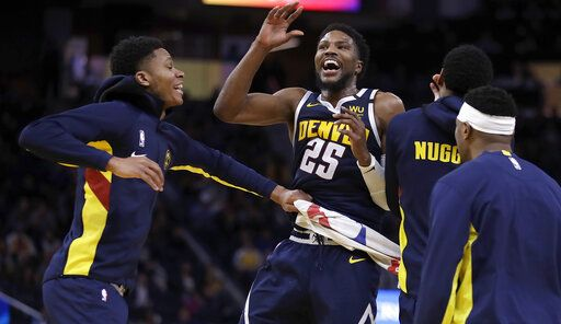 Denver Nuggets' Malik Beasley celebrates a score against the Golden State Warriors during the second half of an NBA basketball game Thursday, Jan. 16, 2020, in San Francisco.