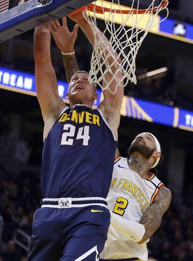 Denver Nuggets' Mason Plumlee (24) shoots past Golden State Warriors' Willie Cauley-Stein during the first half of an NBA basketball game Thursday, Jan. 16, 2020, in San Francisco.