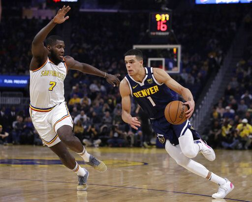 Denver Nuggets' Michael Porter Jr., right, drives the ball against Golden State Warriors' Eric Paschall (7) during the first half of an NBA basketball game Thursday, Jan. 16, 2020, in San Francisco.