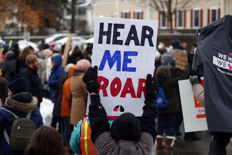 "Participants in Saturday's Fox Valley Women's March carried handmade signs, such as this one saying ""Hear Me Roar,"" as they gathered for a rally in Geneva."