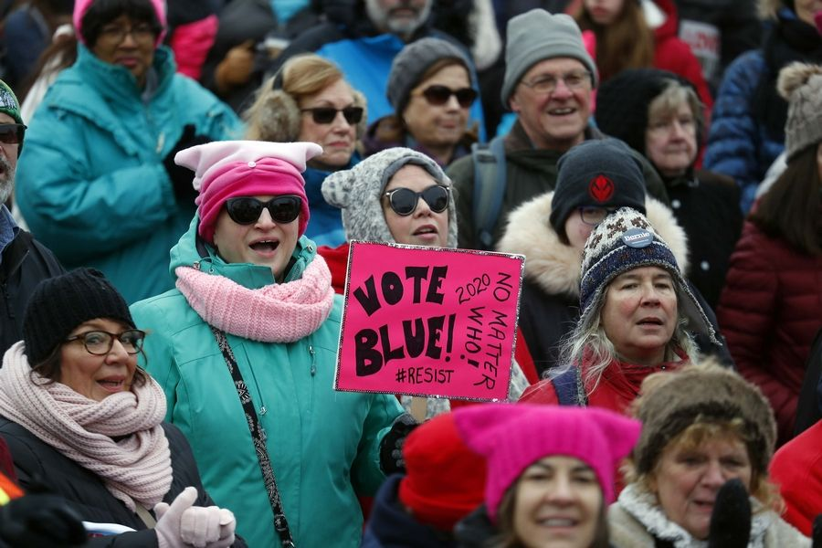 Political messages were displayed throughout the crowd Saturday during the Fox Valley Women's March in Geneva.