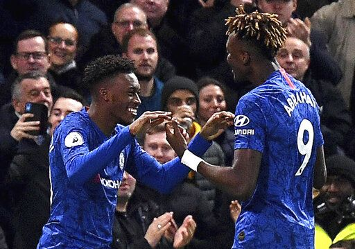 Chelsea's Callum Hudson-Odoi, left, celebrates scoring his side's third goal of the game with teammate Tammy Abraham, during the English Premier League soccer match between Chelsea and Burnley at Stamford Bridge, in London, Saturday, Jan. 11, 2020. (Victoria Jones/PA via AP)