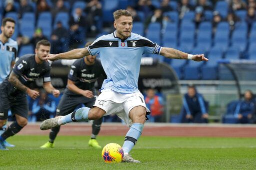 Lazio's Ciro Immobile scores his side's second goal on a penalty shot during a Serie A soccer match between Lazio and Sampdoria, at Rome's Olympic Stadium, Saturday, Jan. 18, 2020.