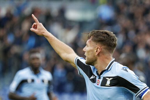 Lazio's Ciro Immobile celebrates after he scored his side's third goal during a Serie A soccer match between Lazio and Sampdoria, at Rome's Olympic Stadium, Saturday, Jan. 18, 2020.