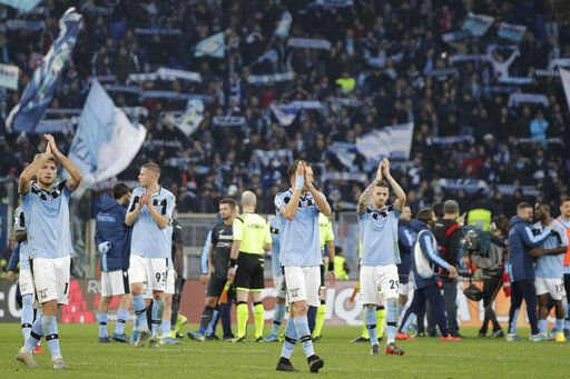 Lazio's players celebrate their victory at the end of the Italian Serie A Soccer match between Lazio and Sampdoria at Rome's Olympic stadium, Saturday, Jan. 18, 2020. Lazio won 5-1.