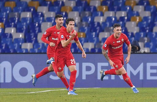 Fiorentina's Federico Chiesa, center, celebrates with teammates after scoring the first goal of the game during the Italian Serie A soccer match between Napoli and Fiorentina, at the San Paolo stadium in Naples, Italy, Saturday, Jan. 18, 2020. (Cafaro/LaPresse via AP)