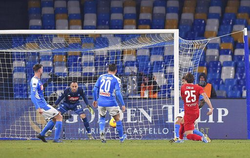 Fiorentina's Federico Chiesa, right, scores the first goal of the game during the Italian Serie A soccer match between Napoli and Fiorentina, at the San Paolo stadium in Naples, Italy, Saturday, Jan. 18, 2020. (Cafaro/LaPresse via AP)