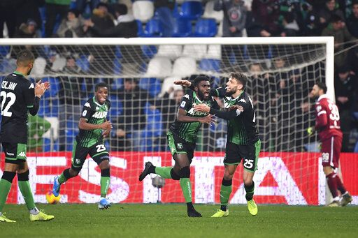 Sassuolo's Jeremie Boga, center, is cheered by teammates after scoring  during the Italian Serie A soccer match between Torino and Sassuolo, in Reggio Emilia, Italy, Saturday, Jan. 18, 2020. (Massimo Paolone/LaPresse via AP)