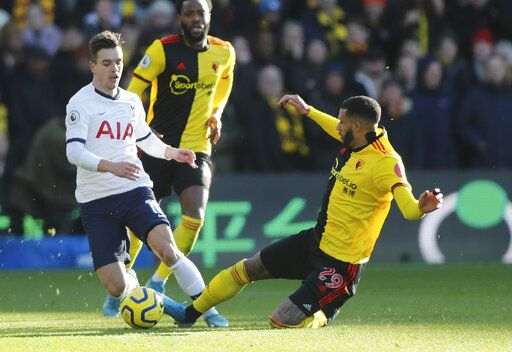 Tottenham's Giovani Lo Celso, left, is tailed by Watford's Etienne Capoue during the English Premier League soccer match between Watford and Tottenham Hotspur at Vicarage Road, Watford, England, Saturday, Jan. 18, 2020.