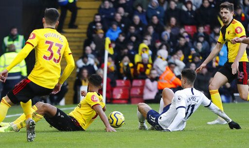 Tottenham's Erik Lamela, right, makes an attempt to score during the English Premier League soccer match between Watford and Tottenham Hotspur at Vicarage Road, Watford, England, Saturday, Jan. 18, 2020.