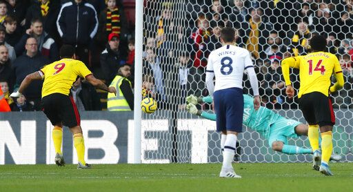 Tottenham's goalkeeper Paulo Gazzaniga saves on a penalty kick by Watford's Troy Deeney during the English Premier League soccer match between Watford and Tottenham Hotspur at Vicarage Road, Watford, England, Saturday, Jan. 18, 2020.