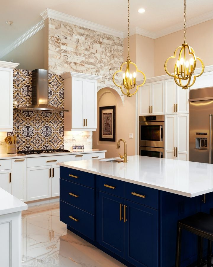 White cabinets are stepping back to make way for more colorful cabinets. In this kitchen, both are used.