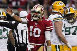 San Francisco 49ers quarterback Jimmy Garoppolo (10) celebrates after converting a first down against the Green Bay Packers during the first half of the NFL NFC Championship football game Sunday, Jan. 19, 2020, in Santa Clara, Calif.
