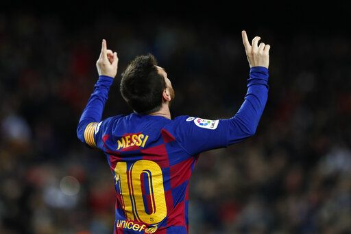 Barcelona's Lionel Messi celebrates after scoring the opening goal during a Spanish La Liga soccer match between Barcelona and Granada at Camp Nou stadium in Barcelona, Spain, Sunday, Jan. 19, 2020.