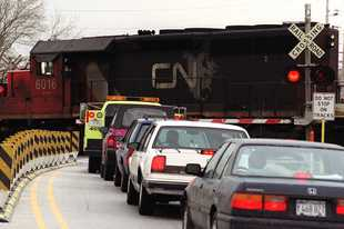 A freight train blocks a crossing in Prospect Heights. The Federal Railroad Administration has created a website to report train delays.