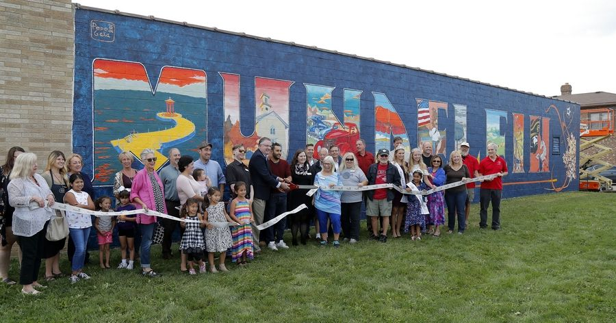 Mundelein officials celebrated the completion of a mural on the side of a downtown building in September 2018.