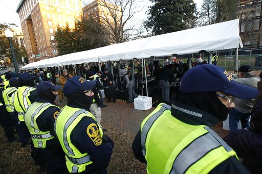Virginia State police troopers stand near a security checkpoint before demonstrators enter the capitol grounds ahead of a pro gun rally, Monday, Jan. 20, 2020, in Richmond, Va.
