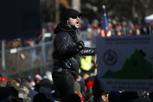 A man speaks during a pro-gun rally, Monday, Jan. 20, 2020, in Richmond, Va. Thousands of pro-gun supporters are expected at the rally to oppose gun control legislation like universal background checks that are being pushed by the newly elected Democratic legislature.