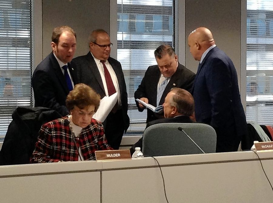 Illinois Racing Board commissioners, including Arlene Mulder of Arlington Heights, and staff members take a brief recess during a nearly four-hour meeting Tuesday.