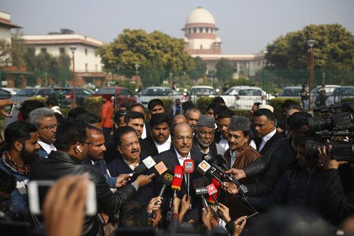 Indian Union Muslim League leader P.K.Kunhalikutty, center, one of the petitioners, speaks to media on the lawns of India's Supreme Court after the top court started hearing dozens of petitions that seek revocation of a new citizenship law amendment in New Delhi, India, Wednesday, Jan. 22, 2020. The new law had led to nationwide demonstrations and a violent security backlash resulting in the death of more than 20 people.