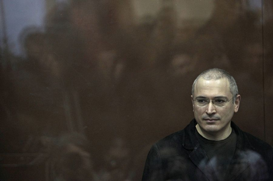 "Mikhail Khodorkovsky looks on from behind a glass enclosure in a Moscow courtroom in 2010. The Russian oligarch-turned-dissident is the subject of the documentary ""Citizen K."""