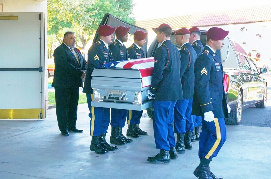 The casket bearing the remains of Army Spc. Miguel Angel Villalon arrives Thursday at Funeraria del Angel Buena Vista Funeral Home in Brownsville, Texas. Villalon, an East Aurora High School graduate, was killed earlier this month in Afghanistan.
