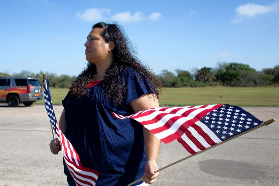 Angelica Mendez waits outside the Brownsville-South Padre Island International Airport on Thursday to pay her respects to late Army Spc. Miguel Angel Villalon.