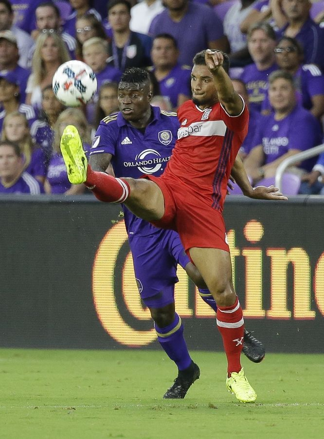 Chicago Fire's Johan Kappelhof, right, clears the ball away from Orlando City's Carlos Rivas during a 2017 game. No player has been with the Chicago Fire longer than Kappelhof, but even he is surprised when considering all the changes the club made this off-season.
