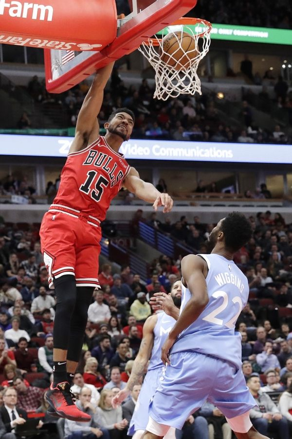 Chicago Bulls forward Chandler Hutchison (15) dunks against the Minnesota Timberwolves during the second half of an NBA basketball game in Chicago, Wednesday, Jan. 22, 2020. The Bulls won 117-110.