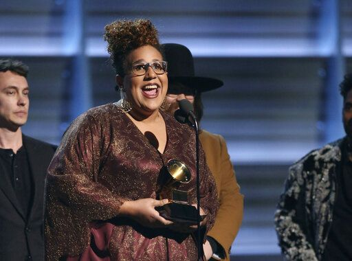"FILE - This Feb. 15, 2016 file photo shows Brittany Howard of The Alabama Shakes accepting the award for best rock performance for ""Don't Wanna Fight"" at the 58th annual Grammy Awards in Los Angeles. Howard's solo album 'œJaime'� is up for two Grammy Awards at Sunday's ceremony. Her song 'œHistory Repeats'� competes for best rock performance and best rock song. (Photo by Matt Sayles/Invision/AP, File)"