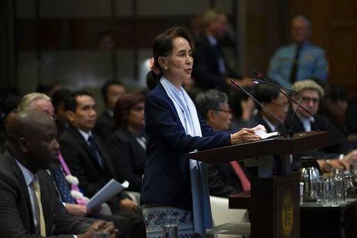 FILE - In this Dec. 11, 2019, file photo, Myanmar's leader Aung San Suu Kyi addresses judges of the International Court of Justice for the second day of three days of hearings in The Hague, Netherlands. The United Nations' highest court is set to rule Thursday, Jan. 23, 2020 on whether to order Myanmar to halt what has been described as a genocidal campaign against the country's Rohingya Muslim minority. The International Court of Justice decision comes in a case brought by the African nation of Gambia on behalf of an organization of Muslim nations that accuses Myanmar of genocide in its crackdown on the Rohingya.
