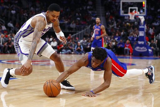 Detroit Pistons guard Langston Galloway, right, and guard Kent Bazemore chase the loose ball during the first half of an NBA basketball game, Wednesday, Jan. 22, 2020, in Detroit.