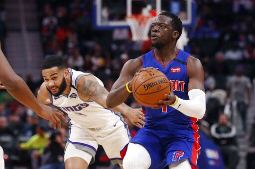 Detroit Pistons guard Reggie Jackson (1) is defended by Sacramento Kings guard Cory Joseph during the first half of an NBA basketball game, Wednesday, Jan. 22, 2020, in Detroit.